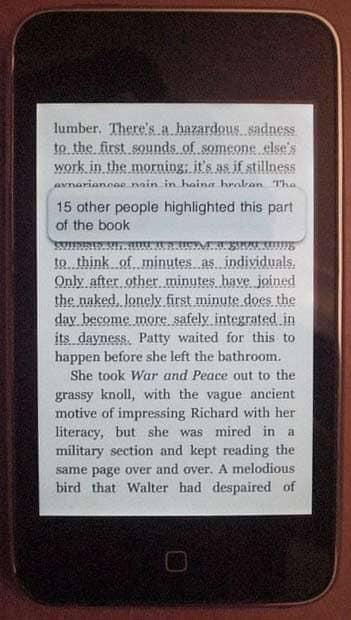 iPhone mit Kindle-E-Book-App und einer beliebten markierten Stelle im Text