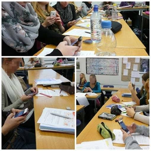 Schüler in der Pause mit ihren Smartphones