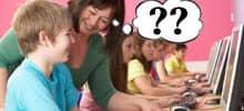 Lehrerin mit Technik-Fragezeichen