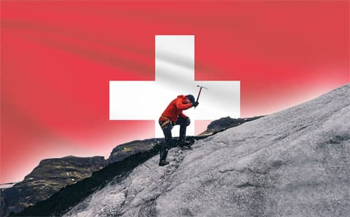 Schweizer Flagge + Bergsteiger